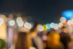 Abstract of blurred people walking in shopping centre at twilight night Stock Photos