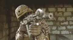 Soldier aiming machine in sight Stock Footage