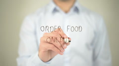 Order Food Online , man writing on transparent screen Stock Footage