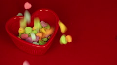 Heart Candies Fall and Fill Up Bowl - stock footage