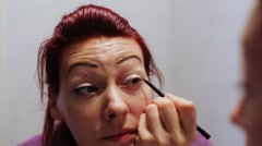 Female Doing Eyelashes Make up - stock footage