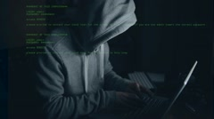Hacker working on a computer Stock Footage
