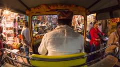 Autorickshaw POV busy illuminated old city streets, Udaipur, Rajasthan, India Stock Footage