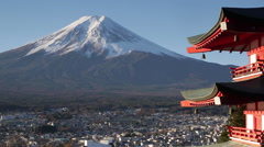 Snowy Mount Fuji and Chureito Pagoda, Arakura-yama Sengen-koen park, Japan - stock footage