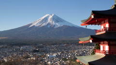 Snowy Mount Fuji and Chureito Pagoda, Arakura-yama Sengen-koen park, Japan Stock Footage