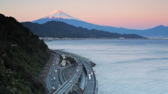 Mt. Fuji and traffic driving on the Tomei Expressway, Shizuoka, Honshu, Japan - stock footage