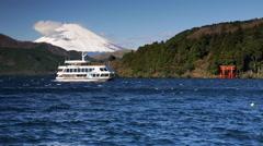 Boat on Lake Ashinoko, Mount Fuji behind, Fuji-Hakone-Izu National Park, Japan Stock Footage