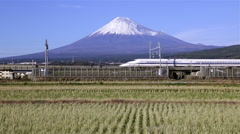Shinkansen Bullet Train passing fields and Mount Fuji, Honshu, Japan - stock footage