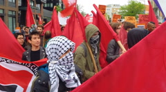 Socialist anarchists march through the streets. - stock footage