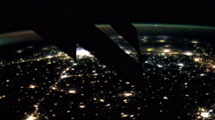 Planet Earth at night seen from the ISS.Elements of this video furnished by NASA Stock Footage