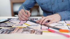 Stylish architect working on blueprint Stock Footage