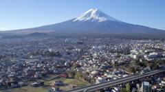 Snowy Mount Fuji in distance, Arakura-yama Sengen-koen park, Japan - stock footage