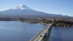 Kawaguchi Lake and Mount Fuji, Honshu Island, Japan, 4K aerial - stock footage