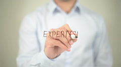Expertise, man writing on transparent screen - stock footage