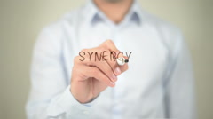 Synergy , man writing on transparent screen - stock footage