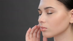Side view of girl touching her face Stock Footage
