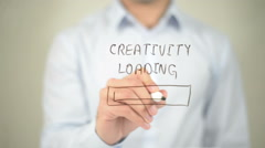 Creativity Loading , man writing on transparent screen Stock Footage