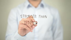 Stronger Than Yesterday , man writing on transparent screen Stock Footage
