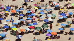 People sunbathing on Copacabana beach, Rio de Janeiro, Brazil, South America Stock Footage