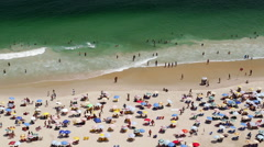 People swimming and sunbathing on Copacabana beach, Rio de Janeiro, Brazil Stock Footage