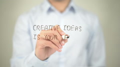 Creative Idea Is Your Fuel , man writing on transparent screen Stock Footage