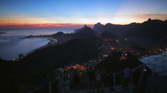 Sunset over Rio de Janiero with Christ the Redeemer statue on Mount Corcovado Stock Footage