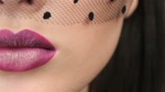 Macro close up of bright lips of veiled face - stock footage