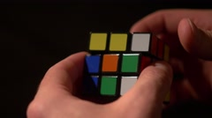 Close up footage of a man solving a Rubik´s cube - stock footage