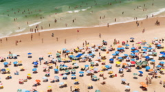 People swimming and sunbathing, Copacabana beach, Rio de Janeiro, Brazil 4K Stock Footage