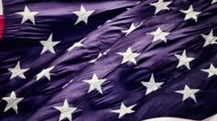 Slow Motion of American Flag Blowing In Wind Stock Footage