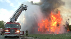 Firefighters battle House Fire in Detroit - stock footage