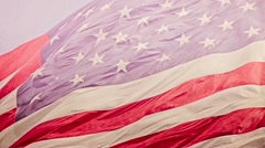 Slow Motion of American Flag Blowing In Wind - stock footage
