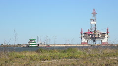 Texas Port Aransas work boat and oil drilling platform Stock Footage