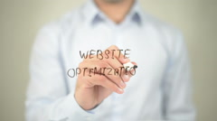 Website Optimization , man writing on transparent screen - stock footage