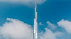 The Burj Khalifa among blue sky with clouds timelapse. Dubai, UAE Stock Footage