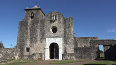 Texas Goliad Presidio La Bahia church with men leaving Stock Footage