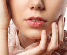 Young woman has chapped lips Stock Photos