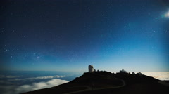 Star time lapse, milky way galaxy moving across the night sky above observatory - stock footage