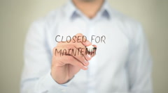 Closed for Maintenance, man writing on transparent screen Stock Footage