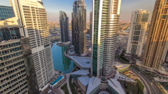 Top view of buildings Jumeirah Lakes Towers with traffic on the road sunset Stock Footage
