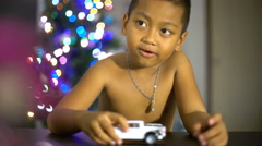 Little boy playing with toy cars in living room 4k (3840x2160) - stock footage