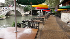 Texas San Antonio River Walk barge and tables Stock Footage