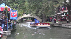 Texas San Antonio River Walk barge moves on river Stock Footage