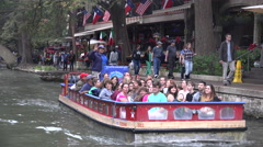 Texas San Antonio River Walk barges move along Stock Footage