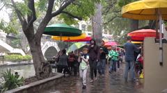 Texas San Antonio River Walk tourists in rain Stock Footage