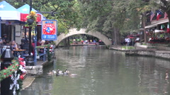 Texas San Antonio River Walk zooms on bridge Stock Footage