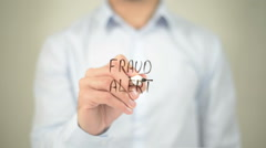 Fraud Alert, man writing on transparent screen - stock footage
