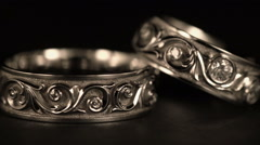 Jewel. White Gold Rings Rotates On A Black Background. Close-Up Stock Footage