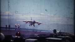3257 US Naval jets land on aircraft carrier at sea - vintage film home movie Stock Footage