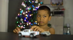 Little asian boy having fun with gift toy cars 4k (3840x2160) Stock Footage